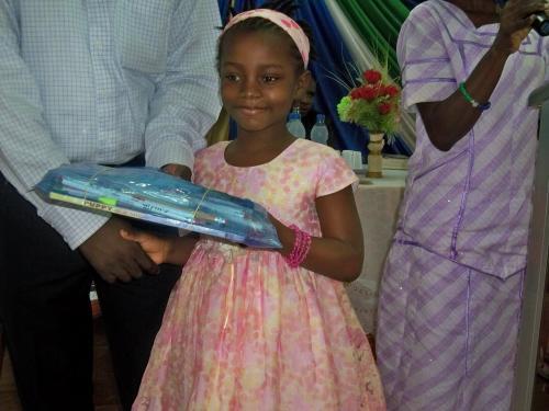 Girl reciving her school supplies
