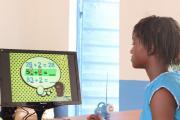 Girl using computer at FAWE lab