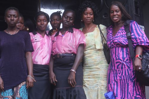 Jasmine with tailoring trainees at Door of Hope