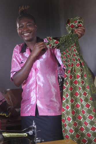 tailoring trainee shows dress she made
